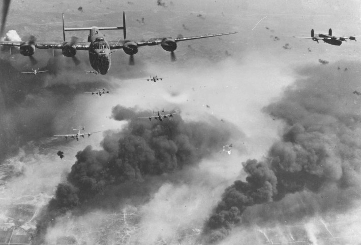 Through flak and over the destruction created by preceding waves of bombers, these 15th Air Force B-24s leave Ploesti, Rumania, after one of the long series of attacks against the No. 1 oil target in Europe. (U.S. Air Force photo)