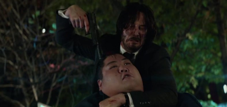 johnwick2-gunpoint-headlock-sumoman