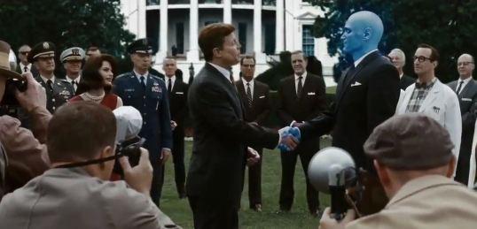 watchmen movie JFK shakes hands with Dr. Manhattan